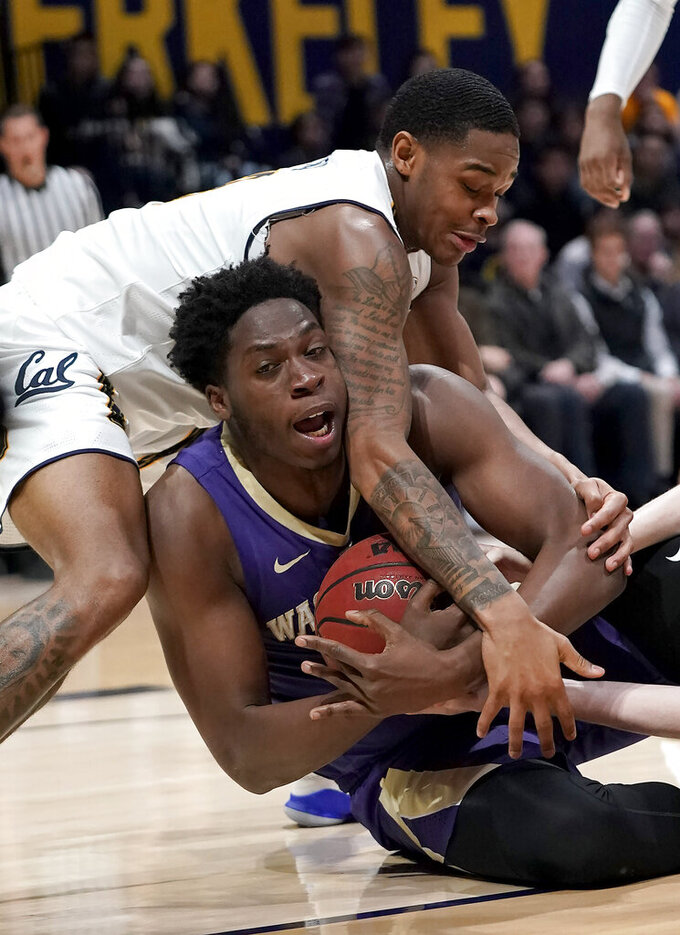 Washington forward Noah Dickerson, bottom, and California guard Paris Austin (3) try to get control of the ball during the first half of an NCAA college basketball game Thursday, Feb. 28, 2019, in Berkeley, Calif. (AP Photo/Tony Avelar)