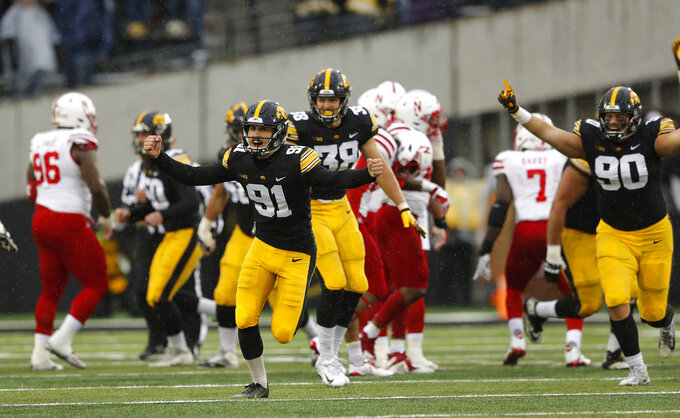 Iowa place kicker Miguel Recinos (91) celebrates after kicking a 41-yard field goal on the final play of an NCAA college football game against Nebraska, Friday, Nov. 23, 2018, in Iowa City, Iowa. Iowa won 31-28. (AP Photo/Charlie Neibergall)