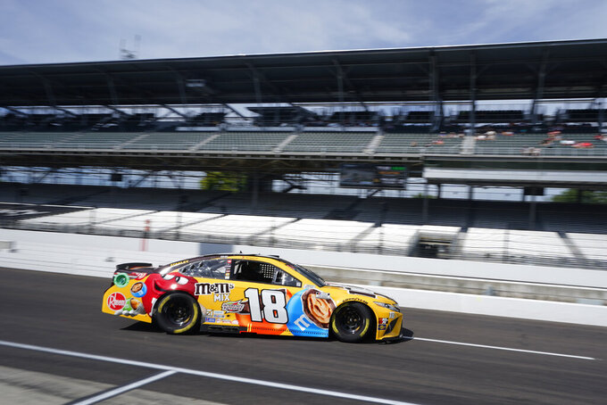 Kyle Busch drives on pit lane during practice for the NASCAR Cup Series auto race at Indianapolis Motor Speedway, Saturday, Aug. 14, 2021, in Indianapolis. (AP Photo/Darron Cummings)