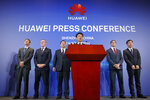 Huawei Rotating Chairman Guo Ping, center, speaks in front of other executives during a press conference in Shenzhen, China's Guangdong province, Thursday, March 7, 2019. Chinese tech giant Huawei is launching a U.S. court challenge to a law that labels the company a security risk and would limit its access to the American market for telecom equipment. (AP Photo/Kin Cheung)