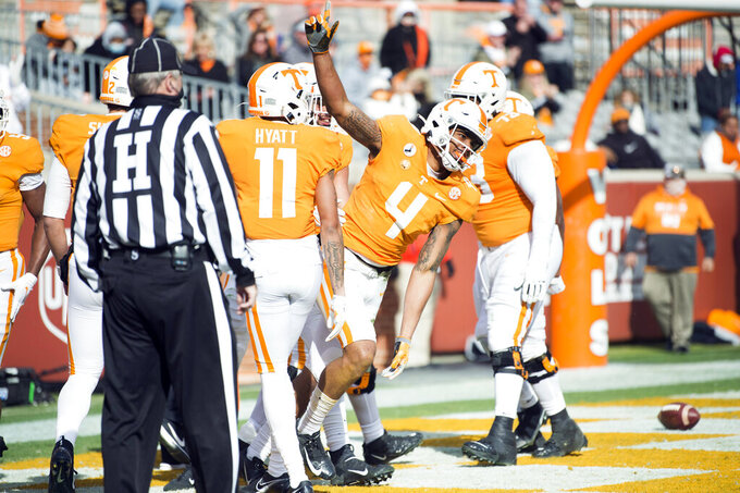 Tennessee wide receiver Cedric Tillman (4) celebrates a touchdown against Texas A&M during an NCAA college football game in Neyland Stadium in Knoxville, Tenn., Saturday, Dec. 19, 2020. (Brianna Paciorka/Knoxville News Sentinel via AP, Pool)
