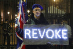 An  Anti Leaving the European Union campaigner stands outside the entrance to Downing Street, in London, Wednesday, March 20, 2019. British Prime Minister Theresa May says she has