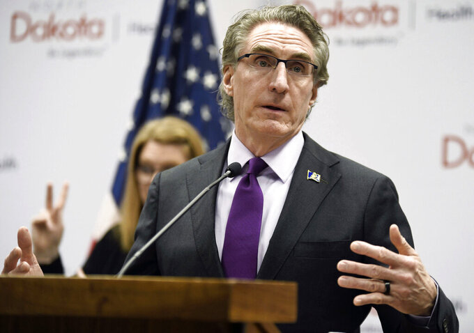 FILE - In this April 10, 2020, file photo, North Dakota Gov. Doug Burgum speaks at the state Capitol in Bismarck, N.D. North Dakota and South Dakota have the nation's worst rate of coronavirus deaths per capita in the last 30 days. Despite advances in treating coronavirus patients, hundreds more people in the Dakotas have died in recent weeks than during any other time of the pandemic. (Mike McCleary/The Bismarck Tribune via AP, File)