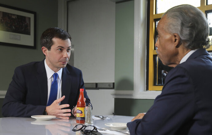 Democratic presidential candidate Mayor Pete Buttigieg, from South Bend, Indiana, and civil rights leader Rev. Al Sharpton, right, President of National Action Network, hold a lunch meeting at Sylvia's Restaurant in Harlem, New York, Monday, April 29, 2019. (AP Photo/Bebeto Matthews, Pool)