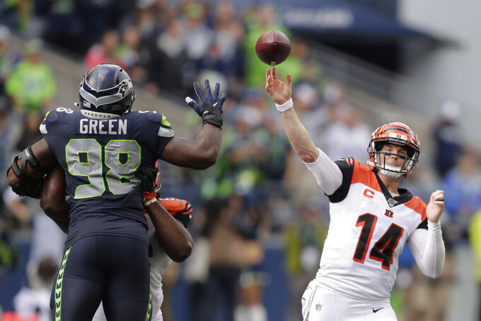 Cincinnati Bengals quarterback Andy Dalton (14) passes under pressure from Seattle Seahawks defensive end Rasheem Green (98) during the second half of an NFL football game Sunday, Sept. 8, 2019, in Seattle. (AP Photo/Stephen Brashear)