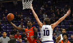 Illinois forward Kipper Nichols (2) shoots past Northwestern center Dererk Pardon (5) during the second half of an NCAA college basketball game on Sunday, Jan. 6, 2019, in Evanston, Ill. (AP Photo/Matt Marton)