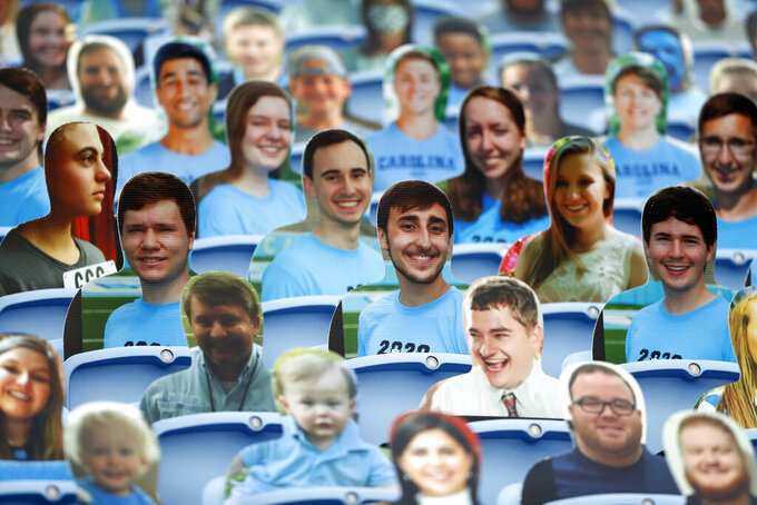 Cardboard fans fill a portion of the seats in Kenan Stadium prior to the Tar Heels' game against Syracuse on Saturday, Sept. 12, 2020, in Chapel Hill, N.C. Fans have been prohibited from attending the game due to the COVID-19 pandemic. (Robert Willett/The News & Observer via AP, Pool)