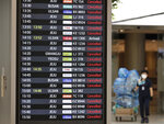 An electronic signboard shows canceled domestic flights at the Gimpo Airport in Seoul, South Korea, Wednesday, Sept. 2, 2020. An offshore typhoon brought torrents of rain to southern Japan on Wednesday heading to the Korean Peninsula as another storm in the Pacific was growing stronger. (AP Photo/Lee Jin-man)