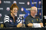 FILE - In this June 25, 2016, file photo, swimmer Allison Schmitt, left, speaks as coach Bob Bowman listens at a news conference at the U.S. Olympic swimming trials, in Omaha, Neb. Schmitt is a graduate student at Arizona State and worked an internship last year counseling students. She's taking a break from her studies this year while attempting to qualify for a fourth Olympics appearance. Schmitt, who turns 30 on June 7, didn't initially plan on trying for one more Olympic bid. (AP Photo/Mark J. Terrill, File)