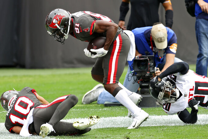 Tampa Bay Buccaneers wide receiver Antonio Brown (81) beats Atlanta Falcons defensive back Kendall Sheffield (20) on a 25-yard touchdown reception during the first half of an NFL football game Sunday, Jan. 3, 2021, in Tampa, Fla. (AP Photo/Mark LoMoglio)