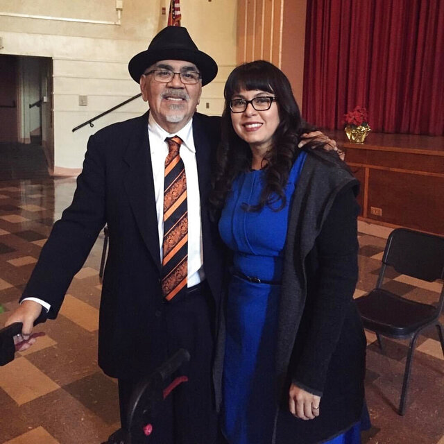 In this December 2016, photo provided by Irene Monica Sanchez, is civil rights leader Bobby Lee Verdugo, left, and Chicano scholar Sanchez posing for a photo after Verdugo was honored at a diploma ceremony at Lincoln High School, in Los Angeles. Verdugo, one of the leaders of the 1968 East Los Angeles high school walkout to protest discrimination and dropout rates among Mexican American students, which triggered a movement across the American Southwest, died Friday, May 1, 2020. He was 69. (Courtesy of Irene Monica Sanchez via AP)