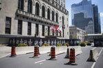 "A section of the street outside Toronto's Royal York hotel is closed off as NHL teams arrive at the ""bubble"" ahead of the return of the league's season following a disruption due to the COVID-19 pandemic, in Toronto, Sunday, July 26, 2020. (Chris Young/The Canadian Press via AP)"