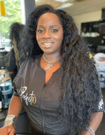 This image provided by Isis Alexander shows cosmetologist Kanessa Alexander. After repeatedly being denied service by high-end salons because her hair was perceived as too difficult to style, Alexander opened a shop of her own in a predominantly white Boston neighborhood with four Black stylists serving all hair textures. Alexander and more than a dozen other people of color in the industry trace such bias and discrimination in predominantly white salons to the sidelining of formal education focused on Black hair. Horror stories are not uncommon, from outright refusal of service to botched treatments and cuts by stylists who don't know what they're doing. (Isis Alexander via AP)