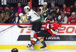 Fans react to Vegas Golden Knights defenseman Nicolas Hague (14) hitting Ottawa Senators right wing Connor Brown (28) during the third period of an NHL hockey game, Thursday, Jan. 16, 2020 in Ottawa, Ontario. (Sean Kilpatrick/The Canadian Press via AP)