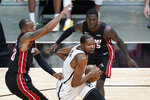 Brooklyn Nets forward Kevin Durant, center, goes up for a shot against Miami Heat forward Andre Iguodala, left, and guard Kendrick Nunn, right, during the first half of an NBA basketball game, Sunday, April 18, 2021, in Miami. (AP Photo/Wilfredo Lee)