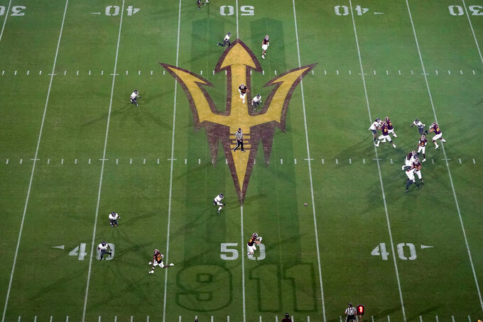 A Sept. 11 memorial is shown on the field during the first half of an NCAA college football game between UNLV and Arizona State, Saturday, Sept. 11, 2021, in Tempe, Ariz. (AP Photo/Matt York)