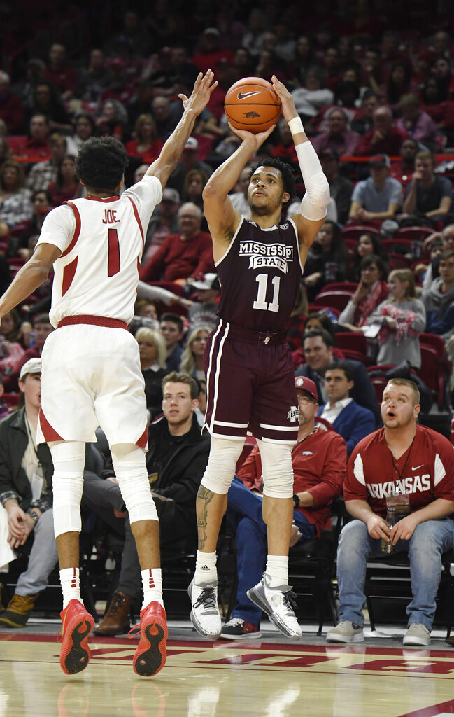 Mississippi State guard Quinndary Weatherspoon (11) shoots a 3-pointer over Arkansas defender Isaiah Joe during the second half of an NCAA college basketball game Saturday, Feb. 16, 2019, in Fayetteville, Ark. (AP Photo/Michael Woods)