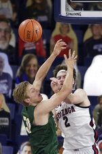 San Francisco center Jonas Visser, left, and Gonzaga forward Drew Timme go after a rebound during the first half of an NCAA college basketball game in Spokane, Wash., Saturday, Jan. 2, 2021. (AP Photo/Young Kwak)