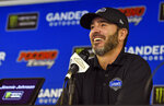 "FILE - In this July 28, 2018, file photo, Jimmie Johnson smiles as he answers questions during a media availability for the NASCAR Cup Series auto race in Long Pond, Pa. Johnson by all measures is one of the politest athletes in sports. But his patience was tested during the worst season of his NASCAR career by criticism sent his way via social media. Unable to always tune it out, the seven-time NASCAR champion clapped back one day with a stern message: ""I'm far from done."" (AP Photo/Derik Hamilton, File)"