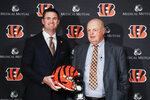 Cincinnati Bengals football head coach Zac Taylor, left, and Bengals owner Mike Brown, right, pose for a photograph during a news conference, Tuesday, Feb. 5, 2019, in Cincinnati. After 16 years without a playoff win under Marvin Lewis, the Bengals decided to try something different. But they had to wait more than a month before hiring Zac Taylor as their next coach in hopes of ending a long streak of futility. (AP Photo/John Minchillo)