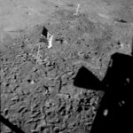 This July 21, 1969 photo made available by NASA shows the U.S. flag planted at Tranquility Base on the surface of the moon, and a silhouette of a thruster at right, seen from a window in the Lunar Module. Rather than let the flag droop, NASA decided to use a right-angled rod to keep it spread out, according to Roger Launius, NASA's former chief historian. Also, Armstrong and Aldrin were worried that the flagpole was going to fall down after they had twisted it into the ground, so they quickly snapped the photos posing next to it, capturing the flag while it was still moving, Launius said. (NASA via AP)