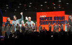 In this Friday, June 7, 2019 photo, The 1985 Super Bowl Champion Chicago Bears are honored on stage during the Bears100 Celebration Weekend at the Donald E. Stephens Convention Center in Rosemont, Ill. (Chris Sweda/Chicago Tribune via AP)