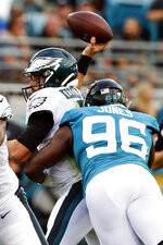 Jacksonville Jaguars defensive end Datone Jones (96) tackles Philadelphia Eagles quarterback Cody Kessler, left, as he tries to throws a pass during the first half of an NFL preseason football game, Thursday, Aug. 15, 2019, in Jacksonville, Fla. Kessler was injured on the play. (AP Photo/Stephen B. Morton)