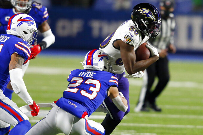 Buffalo Bills' Micah Hyde (23) tackles Baltimore Ravens' Miles Boykin (80) during the first half of an NFL divisional round football game Saturday, Jan. 16, 2021, in Orchard Park, N.Y. (AP Photo/Jeffrey T. Barnes)