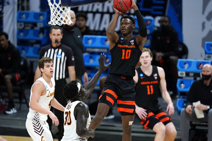 Oregon State forward Warith Alatishe (10) shoots over Loyola Chicago forward Aher Uguak (30) during the second half of a Sweet 16 game in the NCAA men's college basketball tournament at Bankers Life Fieldhouse, Saturday, March 27, 2021, in Indianapolis. (AP Photo/Jeff Roberson)