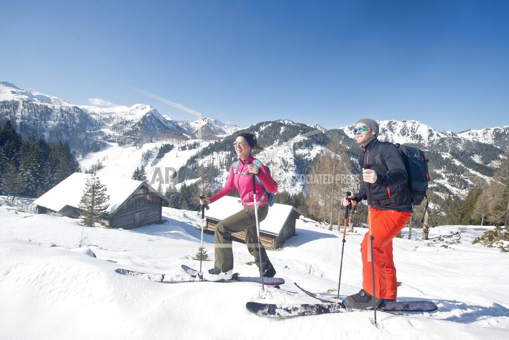 Young couple skiing on snow during vacation