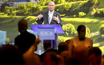 Gov. Spencer Cox speaks during the American Legislative Exchange Council (ALEC) conference as the crowd talks over him and eats lunch at the Grand America Hotel in Salt Lake City on Thursday, July 29, 2021. (Kristin Murphy/The Deseret News via AP)
