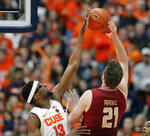 Syracuse's Paschal Chukwu, left, blocks the shot by Boston College's Nik Popovic, right, during the first half of an NCAA college basketball game in Syracuse, N.Y., Saturday, Feb. 9, 2019. (AP Photo/Nick Lisi)