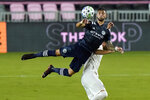 New York City FC midfielder Valentin Castellanos, left, heads the ball as Inter Miami defender Leandro Gonzalez Pirez defends during the first half of an MLS soccer match, Saturday, Oct. 3, 2020, in Fort Lauderdale, Fla. (AP Photo/Lynne Sladky)