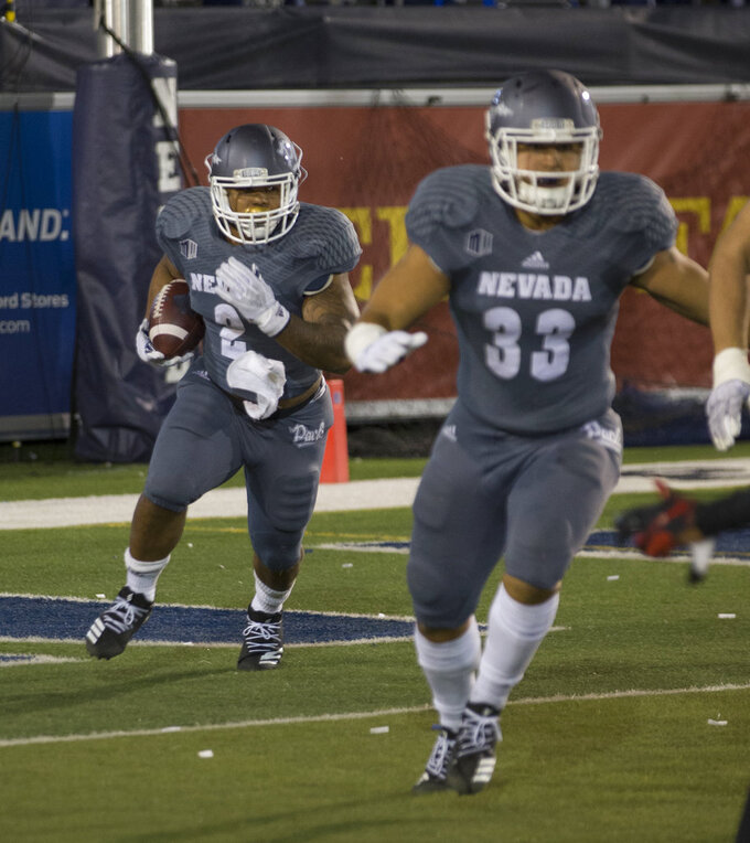 Nevada running back Devonte Lee (2) runs out of his own end zone against San Diego State in the first half of an NCAA college football game in Reno, Nev., Saturday, Oct. 27, 2018. (AP Photo/Tom R. Smedes)