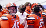 Syracuse coach Dino Babers, center, stands with his team during the playing of the school's alma mater at the end of an NCAA college football game against Wake Forest, Saturday, Oct. 31, 2020, in Syracuse, N.Y. (Dennis Nett/The Post-Standard via AP)