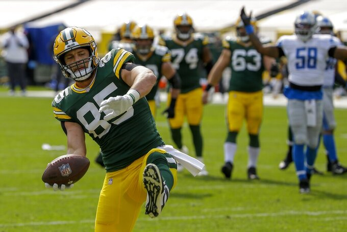Green Bay Packers' Robert Tonyan celebrates his touchdown catch during the first half of an NFL football game against the Detroit Lions Sunday, Sept. 20, 2020, in Green Bay, Wis. (AP Photo/Mike Roemer)