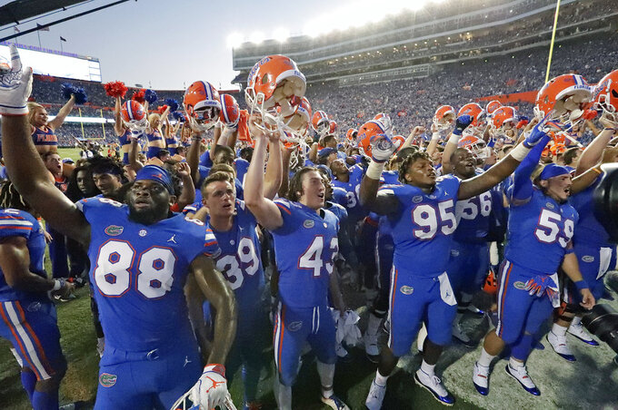 Florida players celebrate in front of fans after defeating LSU 27-19 in an NCAA college football game Saturday, Oct. 6, 2018, in Gainesville, Fla. (AP Photo/John Raoux)