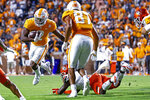 Tennessee running back Jabari Small (2) avoids a Bowling Green defender during the first half of an NCAA college football game Thursday, Sept. 2, 2021, in Knoxville, Tenn. (AP Photo/Wade Payne)