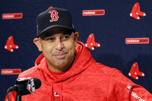 FILE- In this Oct. 21, 2018, file photo, Boston Red Sox manager Alex Cora speaks to media during a baseball work out at Fenway Park in Boston, as they prepare for the World Series against the Los Angeles Dodgers. The Red Sox rehired Cora as manager Friday, Nov. 6, 2020, less than a year after letting him go because of his role in the Houston Astros cheating scandal. (AP Photo/Elise Amendola, FIle)