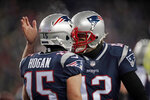 New England Patriots quarterback Tom Brady, right, celebrates his touchdown pass to Chris Hogan during the first half of an NFL divisional playoff football game against the Tennessee Titans, Saturday, Jan. 13, 2018, in Foxborough, Mass. (AP Photo/Charles Krupa)