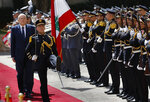 Lebanese Prime Minister Najib Mikati, reviews an honor guard during a ceremony held on his first day in office, at the Government House in downtown Beirut, Lebanon, Monday, Sept. 13, 2021. (AP Photo/Hussein Malla)