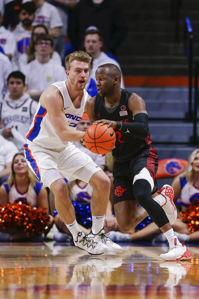 San Diego State guard Adam Seiko (2) drives against Boise State guard Max Rice (12) during the second half of an NCAA college basketball game Sunday, Feb. 16, 2020, in Boise, Idaho. San Diego State won 72-55. (AP Photo/Steve Conner)