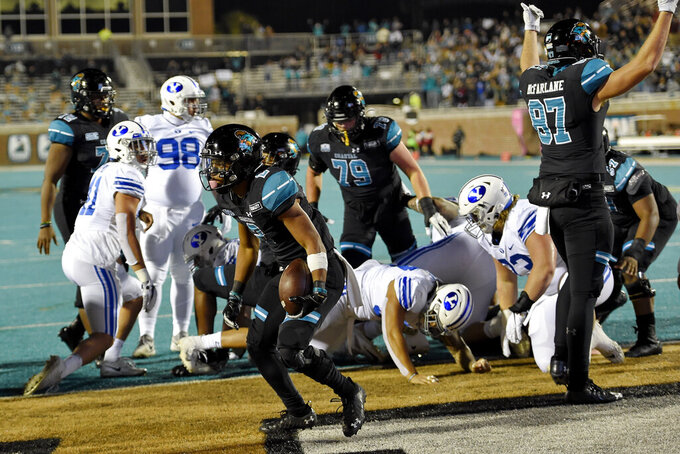 Coastal Carolina's Reese White, center, scores a touchdown during the first half of an NCAA college football game against BYU Saturday, Dec. 5, 2020, in Conway, S.C. (AP Photo/Richard Shiro)