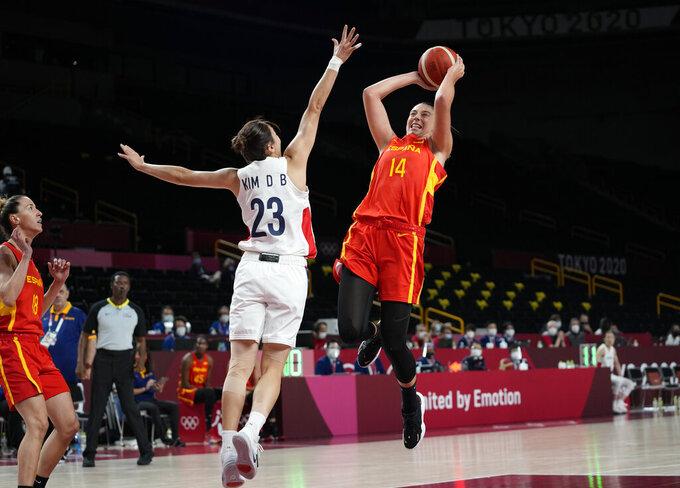 Spain's Raquel Carrera Quintana (14) drives to the basket over South Korea's Danbi Kim (23) during women's basketball preliminary round game at the 2020 Summer Olympics, Monday, July 26, 2021, in Saitama, Japan. (AP Photo/Eric Gay)