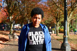 "Teressa Raiford, of Don't Shoot Portland, poses for a photo on Oct. 31, 2017, in Portland, Ore. Protests in Portland have topped the headlines for days, but lost in the shouting are the voices of Black residents themselves Raiford, who is also a former mayoral candidate, said people who are questioning the legitimacy of protest through so-called ""direct action"" against police are on ""the wrong side of history.""  (Jim Ryan/The Oregonian via AP)"