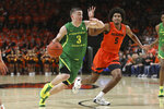 Oregon's Payton Pritchard (3) drives to the basket past Oregon State's Ethan Thompson (5) during the first half of an NCAA college basketball game in Corvallis, Ore., Saturday, Feb. 8, 2020. (AP Photo/Amanda Loman)