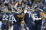 Tennessee Titans quarterback Ryan Tannehill, third from left, celebrates with offensive tackle Dennis Kelly (71) after Tannehill threw a touchdown pass to Kellly in the second half of an NFL football game against the Jacksonville Jaguars Sunday, Nov. 24, 2019, in Nashville, Tenn. (AP Photo/Mark Zaleski)