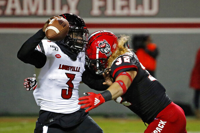 North Carolina State's Drake Thomas (32) sacks Louisville quarterback Micale Cunningham (3) during the first half of an NCAA college football game in Raleigh, N.C., Saturday, Nov. 16, 2019. (AP Photo/Karl B DeBlaker)