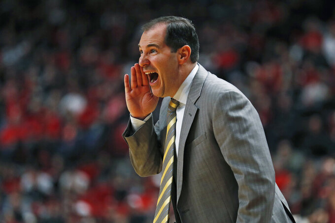 Baylor coach Scott Drew yells out to his players during the first half of an NCAA college basketball game against Texas Tech, Tuesday, Jan. 7, 2020, in Lubbock, Texas. (AP Photo/Brad Tollefson)