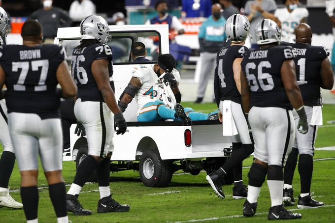 Miami Dolphins outside linebacker Elandon Roberts (44) is driven off the field after he was injured against the Las Vegas Raiders during the second half of an NFL football game, Saturday, Dec. 26, 2020, in Las Vegas. (AP Photo/Steve Marcus)